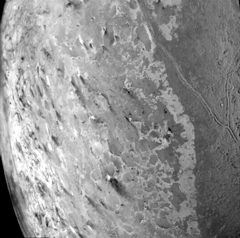 Triton's south polar terrain. About 50 dark plumes mark what may be ice volcanoes.