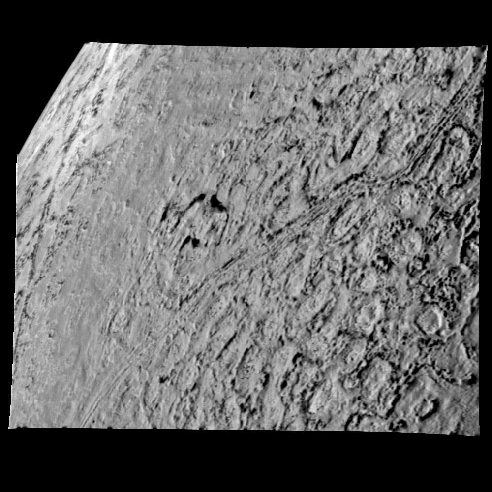 Triton from 25,000 miles. Depressions may be caused by melting and collapsing of icy surface.