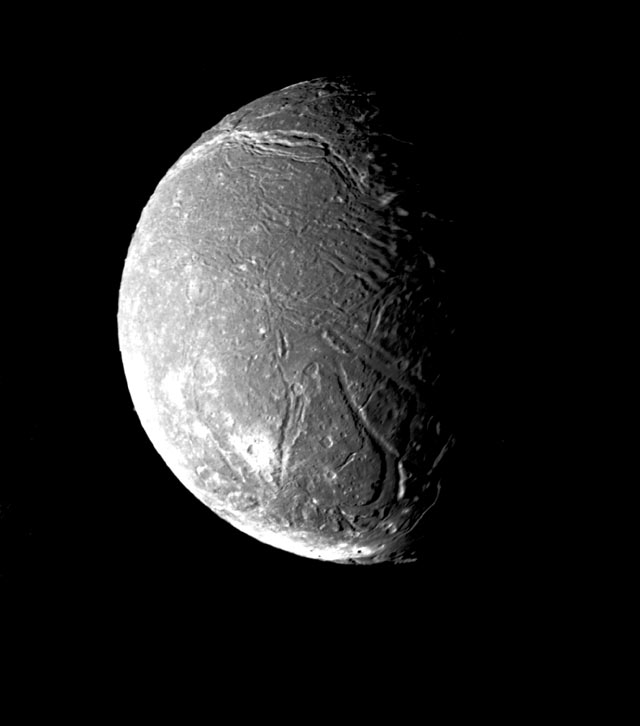 Mosaic of Ariel, most detailed view from Voyager 2 shows numerous faults and valleys. January 24, 1986. Range, 80,000 miles.