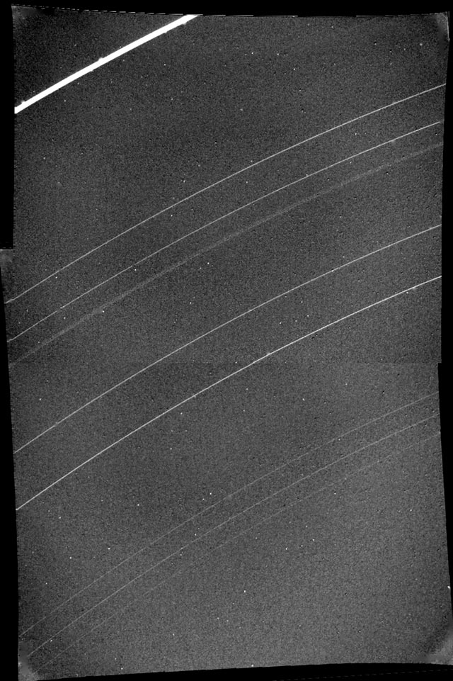 Rings of Uranus, including newly discovered 10th ring designated 1986U1R (barely visible below outermost epsilon ring). January 23, 1986. Range, 690,000 miles.