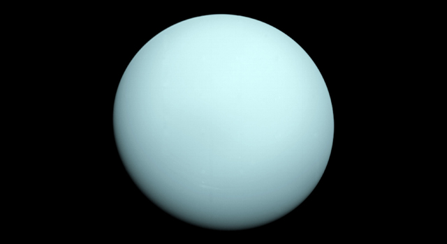 Arriving at Uranus in 1986, Voyager 2 observed a bluish orb with extremely subtle features. A haze layer hid most of the planet's cloud features from view. Credit: NASA/JPL-Caltech