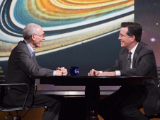 Against the backdrop of an image of Saturn's rings taken by NASA's Voyager mission, project scientist Ed Stone describes the 36-year journey of the two Voyager spacecraft. Stone was a guest on the Colbert Report on Dec. 3, 2013.