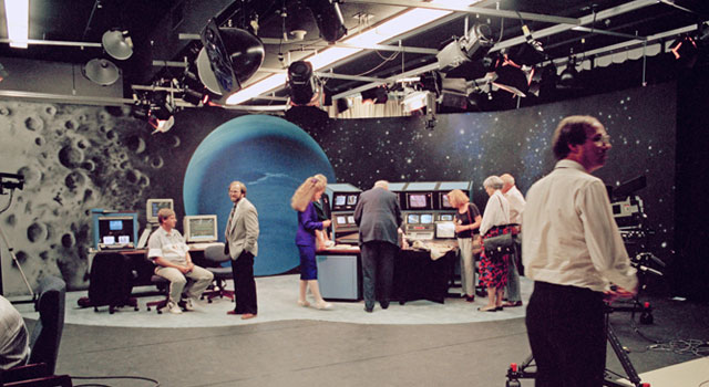 The television studio at NASA's Jet Propulsion Laboratory featured an atmospheric, painted backdrop and live video displays for sharing science data and spacecraft information with the media and public. Image credit: NASA/JPL-Caltech
